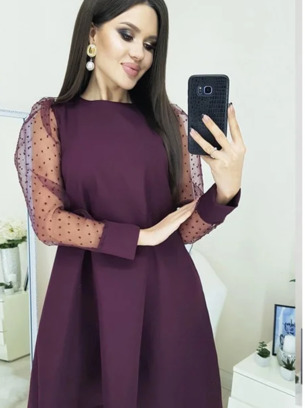 Красивое женское платье с прозрачными рукавами