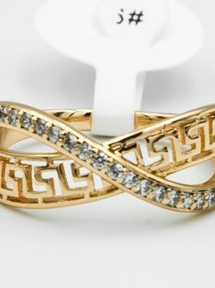 Красивое кольцо оригинальной формы с белыми цирконами и орнаментом