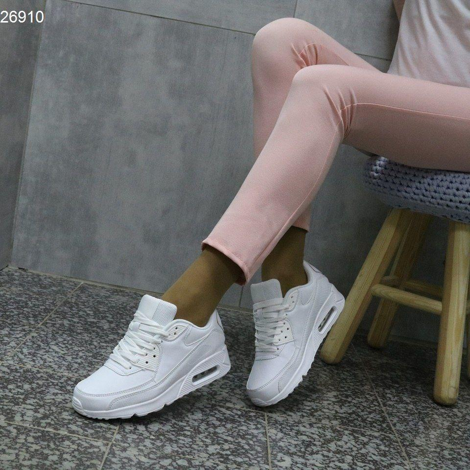 Удобные женские кроссовки на танкетке из эко-кожи