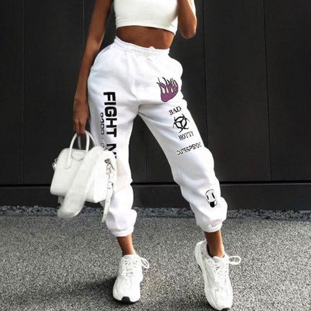 Трендовые женские спортивные штаны на резинке с яркими надписями